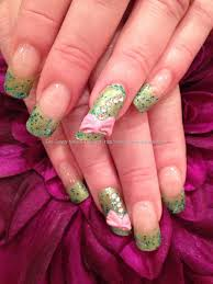 green glitter polish with lipstick shaped ring fingers with 3d