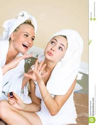 two girls applying nail polish stock image image 9279261