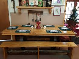 rustic pine table with wagon wheel base rusty nails of ocala