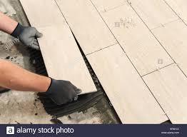 Laying Ceramic Floor Tile Laying Ceramic Tiles Placing Ceramic Floor Tile In Position