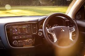 mitsubishi outlander 2015 interior what is the mitsubishi outlander phev gx4h all about