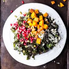 harvest kale salad with squash pomegranate feta and a maple