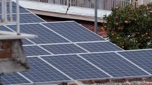 solar panels on roof timelapse shot of sun light walking over solar panels located on