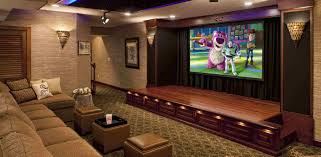 large modern design home movie theater with cream sofas on the