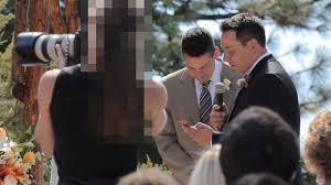 photographer and videographer wedding photographer blocks the videographer s