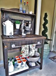 diy potting bench turned outdoor bar garden and house plants