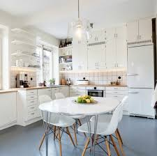 small kitchen decorating ideas with white retro table and chairs