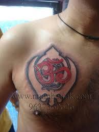 religious om with khanda punjabi on chest by mumbai ink