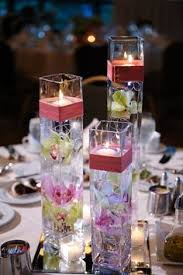 Vase Wedding Centerpiece Ideas by A Fake Flower Submerged In A Dollar Store Vase Because Real