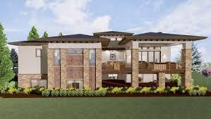 modern prairie house plans modern prairie house plan for a rear sloping lot 64421sc