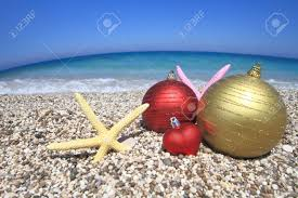 christmas ornaments on the beach stock photo picture and royalty