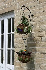 Garden Baskets Wall by Round Hand Hanging Basket Bracket Garden Features Ideas