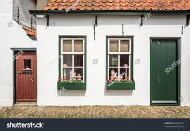 typical dutch house tiled roof windows stock photo 369998015