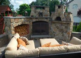 traditional style patio design with isokern outdoor fireplace