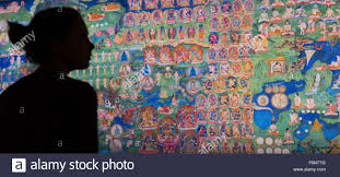 london uk 18 november 2015 pictured wellcome collection pictured wellcome collection employees look at the the lukhang murals from the meditation chamber in the lukhang taken by photographer thomas laird