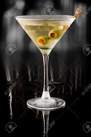 martini bacardi dirty vodka martini served on a dark bar garnished with large