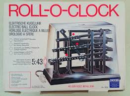 time machine rolling ball clock omg my parents own this clock