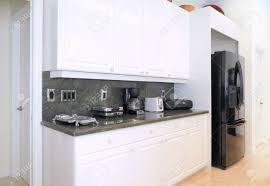 Modern Kitchen White Cabinets by View Of A Beautiful Modern Kitchen With Upscale Appliances White