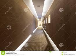 Modern Floor Long Hotel Corridor With Modern Floor And Ceiling Lights Stock