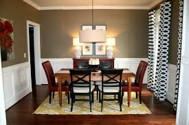 dining room with wainscoting and brown furniture good paint