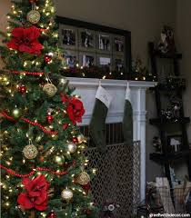 green with decor decorating the living room for christmas on a