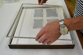 how to hang picture frames that have no hooks how to hang paintings everything you need to know christie s