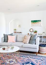 at home with local lejos founder sheeva sairafi rue living living room with grown up pastels pale grey sofa patterned rug at home with local lejos founder sheeva sairafi