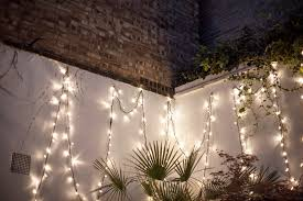 lights on wall with pictures white string lighting for tropical garden design with palm plants