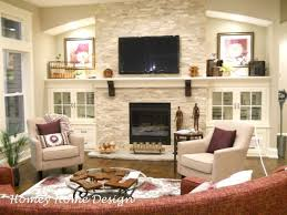 fireplace wall maybe tuck a smaller tv inside the side cabinet instead of over mantle