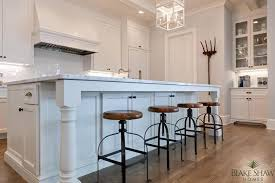 wood legs for kitchen island kitchen island with backless brass nailhead counter stools
