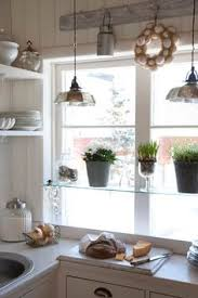 kitchen window shelf ideas diy glass shelves in front of kitchen window glass shelves