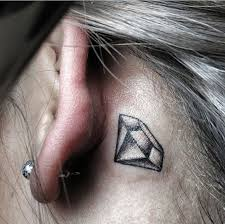 black ink diamond tattoo on behind the ear