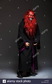 halloween monsters background halloween monster with red face on dark background stock photo