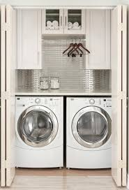 Laundry Room Storage Between Washer And Dryer by Laundry Room Hidden Laundry Images Hidden Laundry Room Ideas