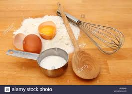 Baking Whisk by Baking Ingredients Flour Egg And Sugar With A Wooden Spoon And