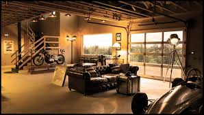 20 cool living spaces inside of garages living rooms room and large california garage turned into an awesome man cave with a leather couch a raised platform for the bike and a spot to house the racing car