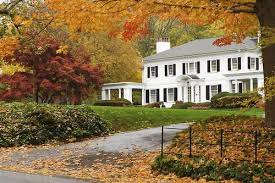 new houses being built with classic new england style things that inspire a classic white house black shutters