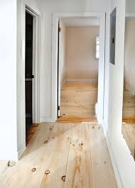 to achieve this look the homeowners stained the floor white