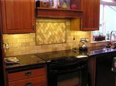 Harlequin Backsplash - kitchen counters features tiled granite counterops and travertine