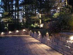 elegant front entrance with landscape lighting bluestone walkway