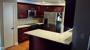 kitchen cabinets with black crown molding