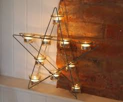 star shaped tea lights black metal star shaped tea light holder by parlane from home treats