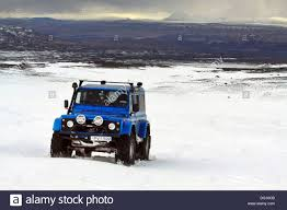 land rover snow blue land rover heavily modified driving on glacier in iceland