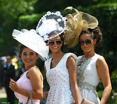ascot ladies day racegoers in supersized hats and chic dresses