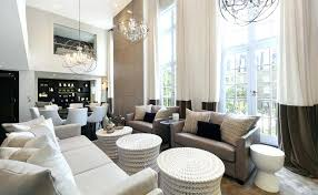 gray and white living room living room high ceilings color block round white benches gray high
