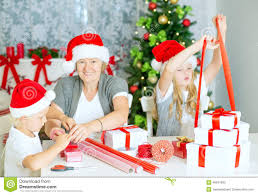family wrapping christmas gifts stock photo image 46641865