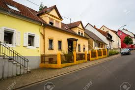 colorful traditional german houses and empty road small european
