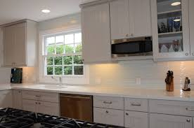 modern white glass subway tile backsplash vertical white glass