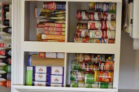 the crunchy country mama kitchen cabinet and pantry reorganization now all the cans are back in the cabinet but they re organized and easy to see and grab we still have a lot of chips bags in the pantry