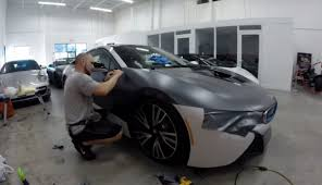 modified bmw i8 watch the bmw i8 receive a custom matte black wrap video